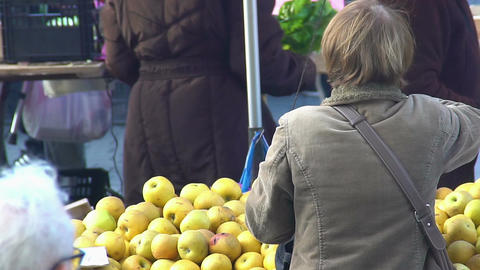 Adult woman making purchase at market, buying apples, healthy eco food Footage
