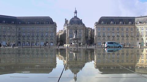 Tourists walking at famous Place de la Bourse square in Bordeaux, France Live Action
