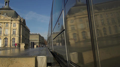Modern tram driving away from station, city transportation, urban life. Slow-mo Footage
