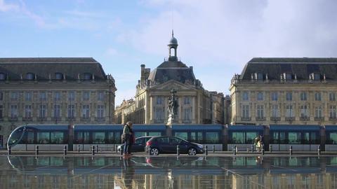 City traffic near Place de la Bourse square in Bordeaux, famous architecture Live Action
