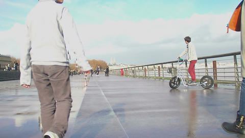 Teenagers walking with their parents along waterfront, happy childhood, slow-mo Footage