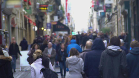Unrecognizable crowd walking down the street, people enjoying weekend in city Footage