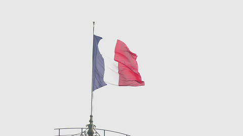Beautiful French flag hanging on top of building, waving in wind, slow motion Footage