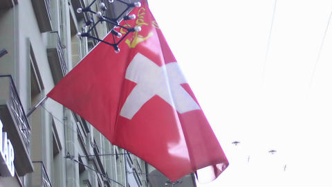 Swiss flag with Cruising Club Schweiz sign flapping in wind, national symbol Footage
