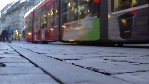 City tram carrying passengers along central street, public transport service Footage
