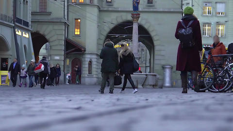 Slow-mo of people walking in old town square, tourists viewing sights, city life Footage