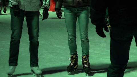 Adults and children having fun on public skating rink, enjoying active rest Footage