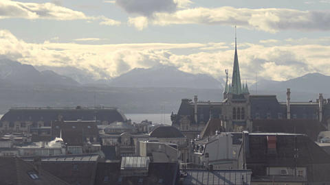 Gothic spire of Saint Francois Church, misty cityscape of Lausanne, Switzerland Footage