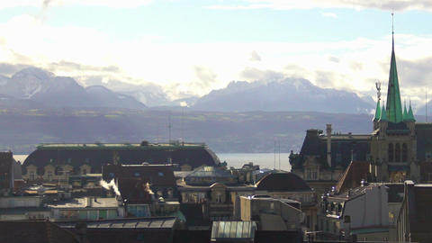 Roofs of old town in Lausanne on bank of Lake Geneva, majestic Alps on horizon Footage