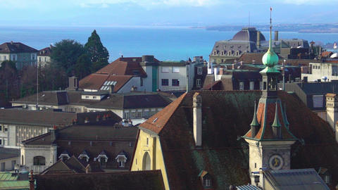 Beautiful view of blue Lake Geneva, red roofs and Gothic spires in Lausanne Footage