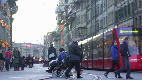 Indifferent people walking by disabled person, nobody helps woman in wheelchair Live Action