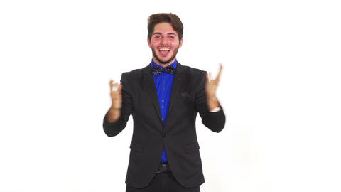 Young happy man on white background celebrating his achievement Footage
