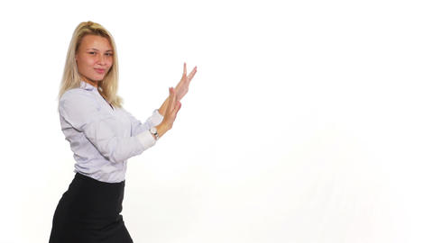 Attractive female pulling an invisible rope and presenting something Footage