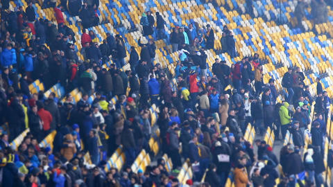 Pleased spectators leaving football stadium after match, people enjoying weekend Footage