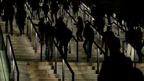 Silhouettes of people walking upstairs, crowd entering sports stadium, tourists Footage