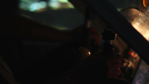 Hands of pilot on steering wheel navigating flight over illuminated night city Footage