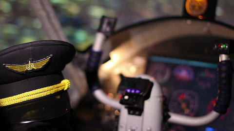 Pilot hat in flight training simulator at flying school, education opportunity Live Action