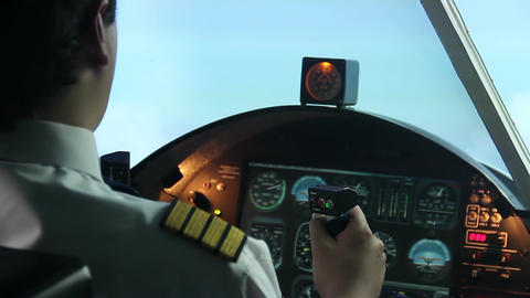 Attentive pilot controlling passenger aircraft, air transportation, travel Footage
