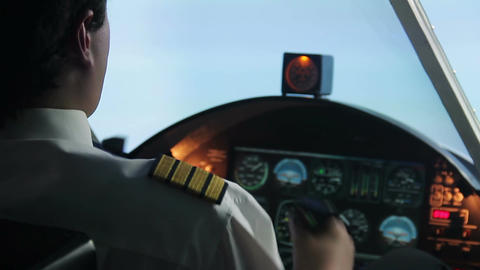 Confident airliner pilot flying in turbulence zone, keeping flight under control Footage
