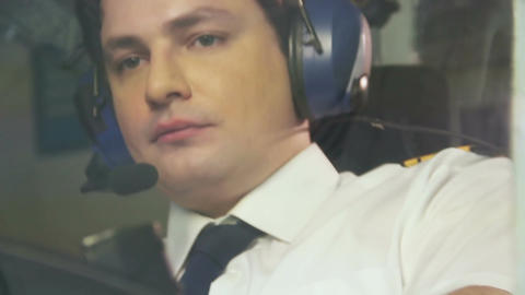 Sleepy tired aviator controlling airplane, overworked man, stressful job Live Action