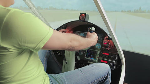 Teacher helping aviation school student control steering wheel, flight simulator Footage