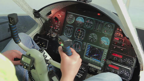 Amateur pilot switching controls, starting engine,... Stock Video Footage