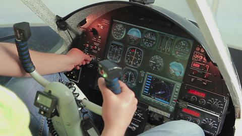 Amateur pilot switching controls, starting engine, preparing for plane takeoff Footage