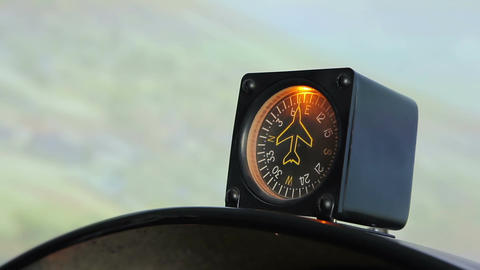Close-up of aircraft compass guiding pilot during flight, showing direction Footage