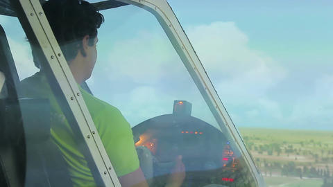 Male pilot navigating light sport aircraft, maneuvering with steering wheel Live Action