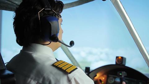 Airliner crew commander navigating plane in blue sky, passenger transportation Footage