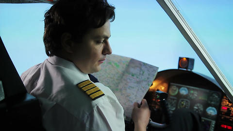 Unreliable airline pilot wearing captain uniform lost direction, checking map Footage