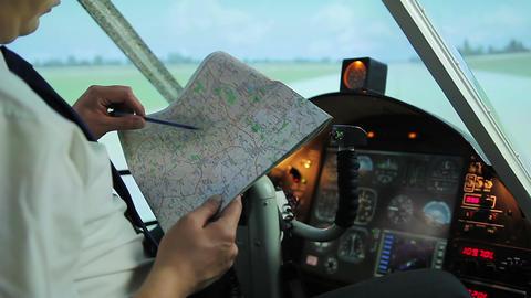 Civil aviation pilot preparing for departure, checking flight destination on map Live Action