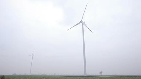 Two Wind Turbines Working Footage