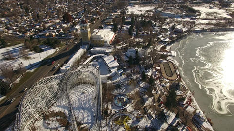 Aerial drone fly closeup closed snow covered amusement park for the winter seaso Footage