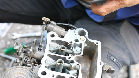 Auto Mechanic or Car Mechanic Repairing Carburetor in Car Repair Shop Live Action