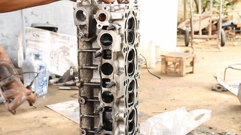 Auto Mechanic or Car Mechanic Maintenance Cylinder Head of Car Live Action