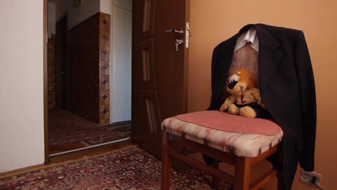 Bear and jacket put on a chair 68 Footage