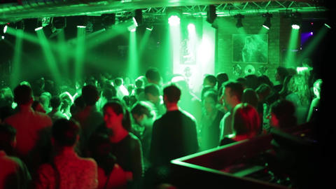 Group of young people dancing in club green light reflectors and laser 4043 Footage