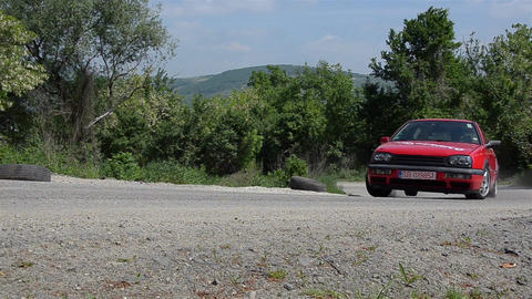Red car rally browse through tight bends before reaching the final 6950 Footage