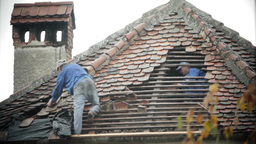 Workers covering a roof with tile 01 Footage