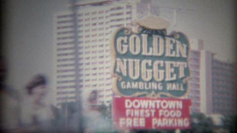 1965: Retro Golden Nugget Hotel Casino Gambling Hall downtown road sign Footage