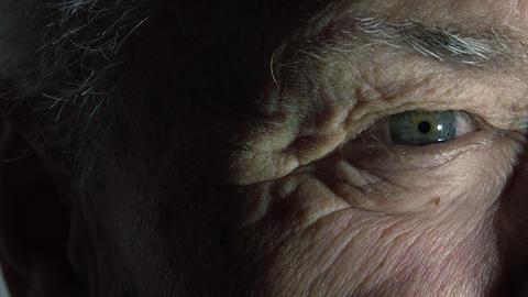 closeup portrait of an elderly wrinkled man: old man's eye Footage