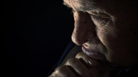 old man praying in the dark: elderly man praying in the darkness Footage