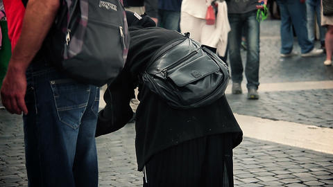 beggar woman asking for charity in the city centre: poor woman, homeless Footage