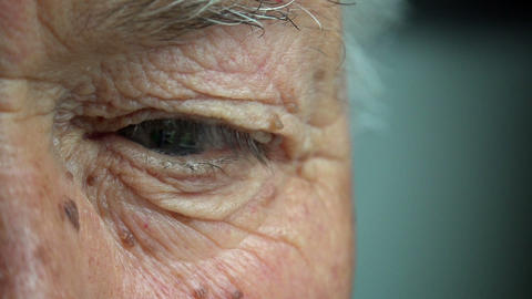old man eye closeup outdoor portrait: desperate old man's eyes Footage