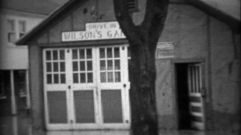 1936: Wilson's Garage general repair work on all cars flooded from storm Footage