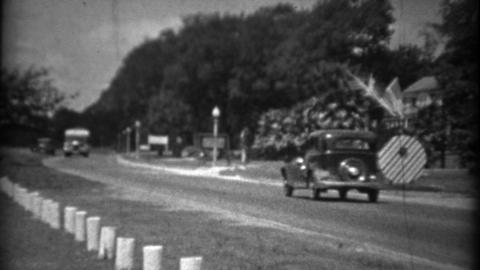 1934: Car bus travel along coastal road beachside resort area Footage