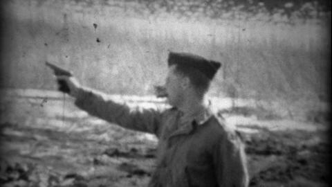 1934: Garrison cap solider practice shooting a Colt pistol gun with cigar Footage