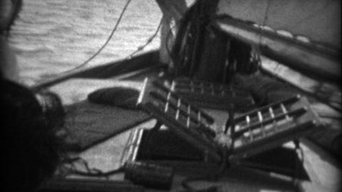 1934: Aboard sailboat trip swabbies pith helmets white sailor captain Footage
