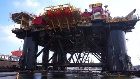 Floating production facility (oil rig platform) during renovation at shipyard Footage